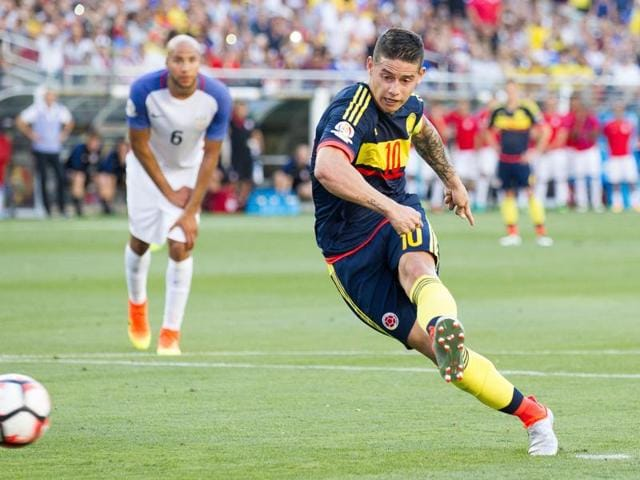 Colombia's James Rodriguez takes a penalty kick to score against the USA during the Copa America.