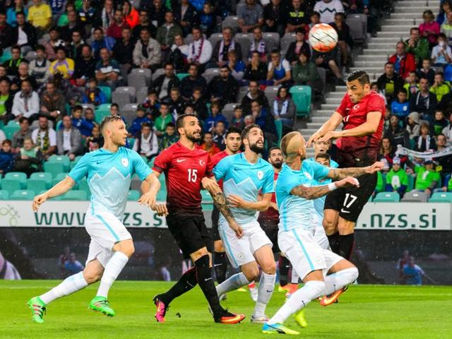Turkey's Burak Yilmaz (right) heads the ball during the friendly football match Turkey versus Slovenia at the Stadium Stozice in Ljubljana.