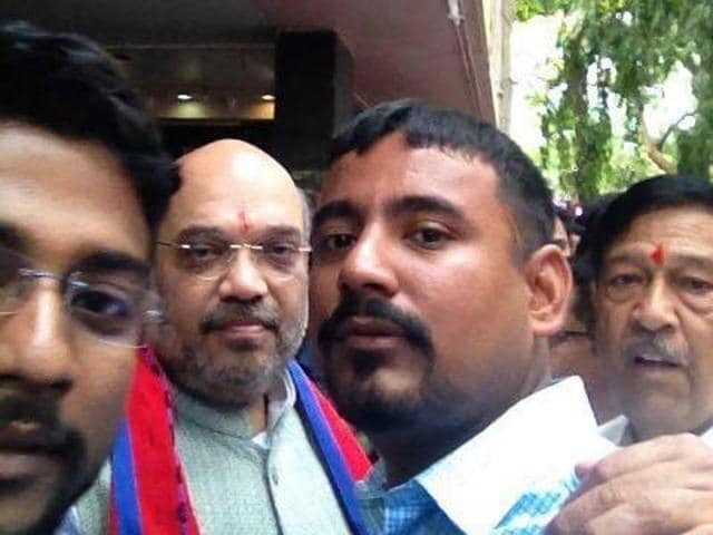 Manas Deka poses for a selfie with BJP president Amit Shah at Pune.