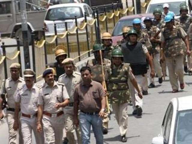 Security forces taking out a flag march in Rohtak on June 4.