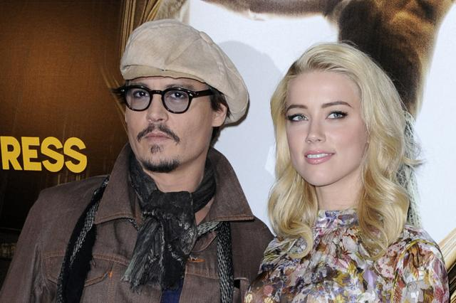 Johnny Depp and Amber Heard pose for photographers during a photocall for the film The Rum Diary in Paris.