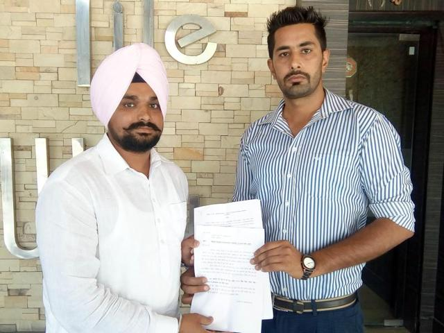 Affected sportspersons Amandeep Singh (turbaned) and Mahavir Singh showing documents in Amritsar on Sunday.