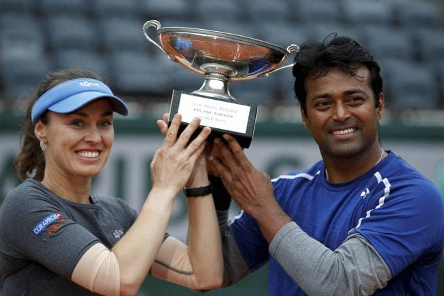 Switzerland's Martina Hingis (left) and Leander Paes hold the trophy after winning the mixed doubles final of the French Open tennis tournament against Sania Mirza and Croatia's Ivan Dodic at the Roland Garros stadium in Paris, France.