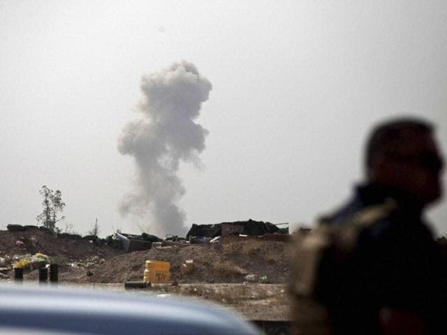 Smoke rises from a car bomb by exploded by the Islamic State on the front line in Fallujah, Iraq.