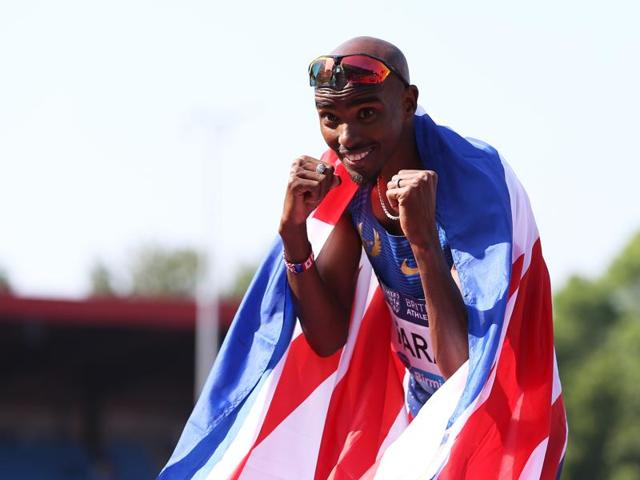 Great Britain's Mo Farah celebrates winning the men's 3000m during the IAAF Diamond League event at the Alexander Stadium, Birmingham, England.