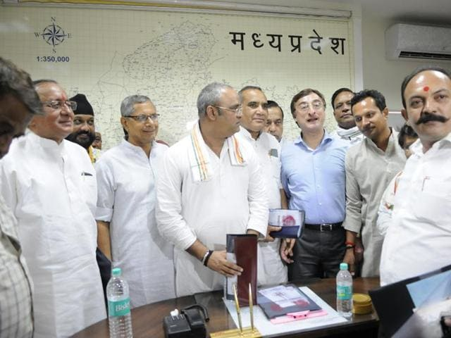 Vivek Tankha and Suresh Pachauri at PCC office during a special meeting for Rajya Sabha election, in Bhopal on Monday.