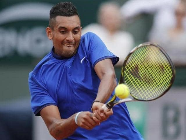 Nick Kyrgios returns the ball during the French Open.
