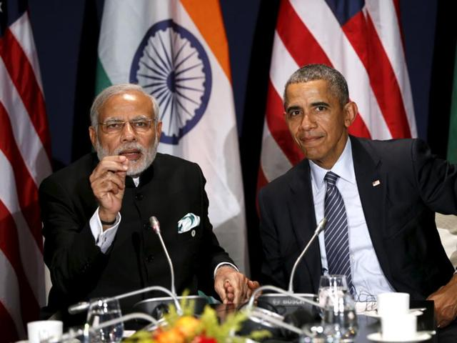 US President Barack Obama  and Prime Minister Narendra Modi during a meeting at the climate change summit in Paris, November 30, 2015.