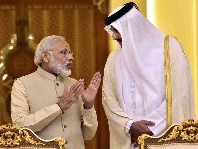 Prime Minister Narendra Modi and Emir of Qatar Sheikh Tamim bin Hamad Al-Thani during signing of agreements at a ceremony at Emiri Diwan in Doha, Qatar on Sunday.