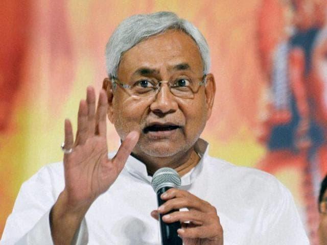Patna: Bihar Chief Minister Nitish Kumar addressing to Prabhu Kripa Dukh Niwaran Samagam in Patna Gandhi Maidan on Sunday night. PTI Photo(PTI6_6_2016_000123b)