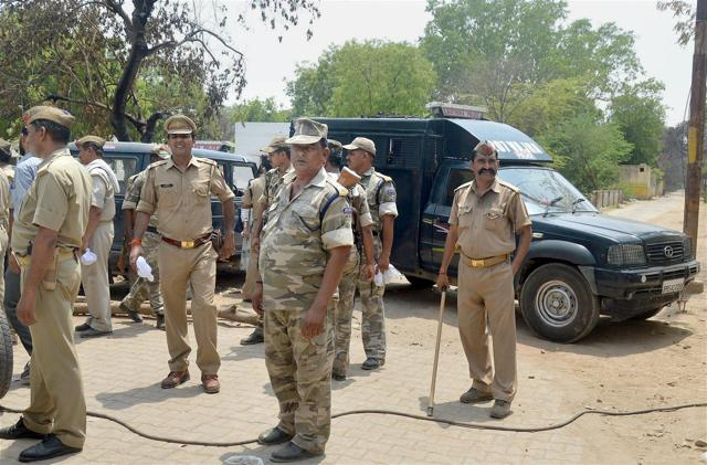 Police officers outside Jawahar Bagh in Mathura on Sunday.
