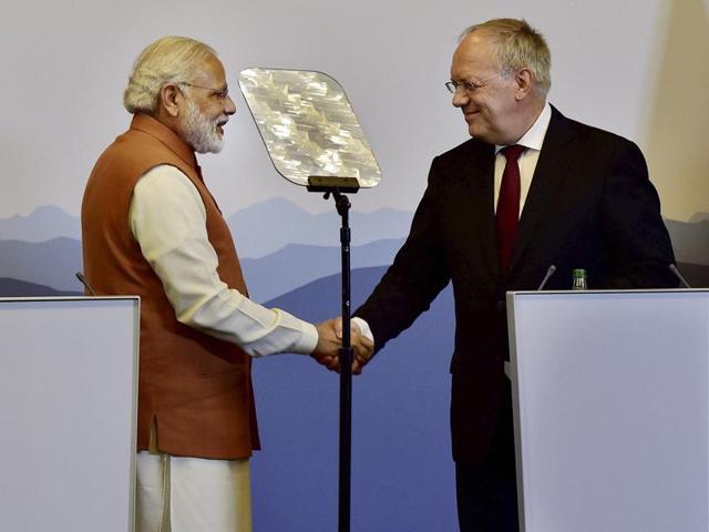Prime Minister Narendra Modi greets Switzerland President Johann Schneider-Ammann during their press statement in Geneva, Switzerland on Monday.