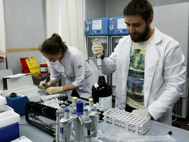 Technicians Ilya Podolsky and Natalia Bochkaryova work at the Russian anti-doping laboratory in Moscow.