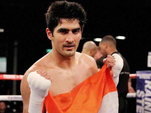 Boxer Vijender Singh celebrates his sixth successive victory in Pro-boxing after a comfortable knockout win over Poland's Andrzej Soldra in Bolton.