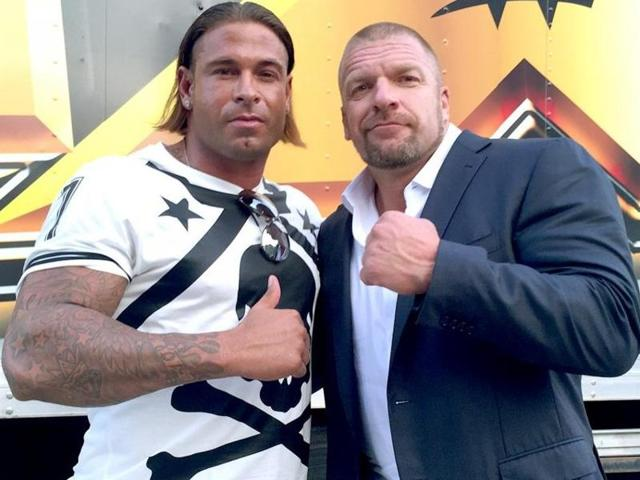 Tim Wiese poses with Triple H.