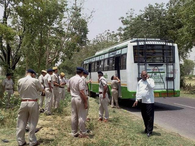 Policemen check a passenger bus hit by a low-intensity explosion near Bhuna in Fatehabad district.
