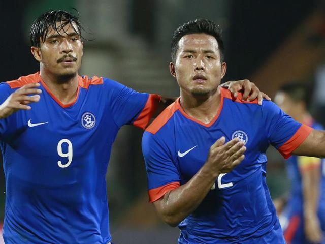 Je Je Lalpekhlua, right, of India celebrates after scoring a goal against Laos.