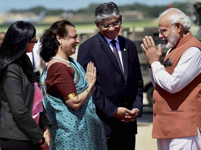 Prime Minister Narendra Modi meets Indian community people after  his arrival at Andrews Air Force Base in Washington on Monday.
