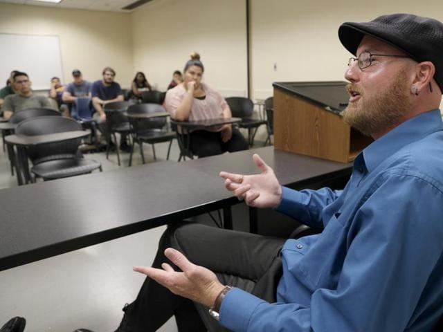 Ryan Reyes, whose partner Daniel Kaufman was killed in the San Bernardino terrorist attack, speaks to students at California State University.
