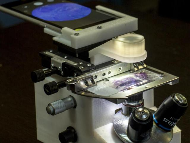 The microscope is smaller than the conventional ones used in labs