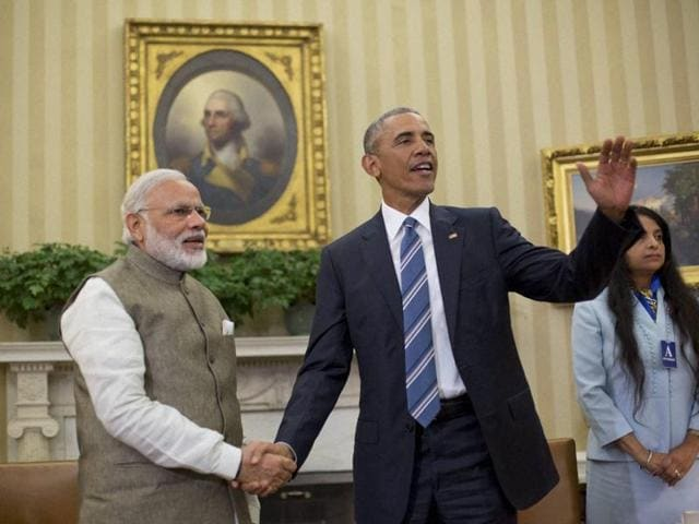 President Barack Obama and Prime Minister Narendra Modi shake hands in the Oval Office of the White House in Washington.