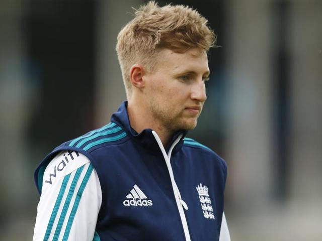 England's Joe Root walks as the players go off due to rain during a nets session at Lord's Cricket Ground, London.