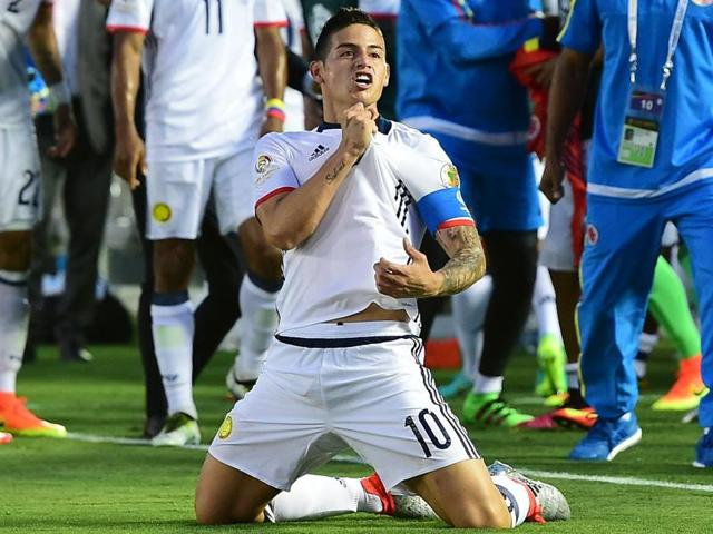 James Rodriguez celebrates after scoring Colombia's second goal.