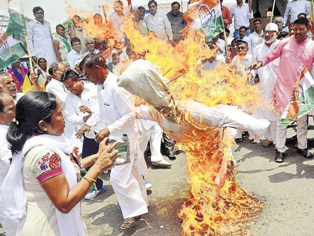 The woman was pouring kerosene on the effigy when she caught fire.