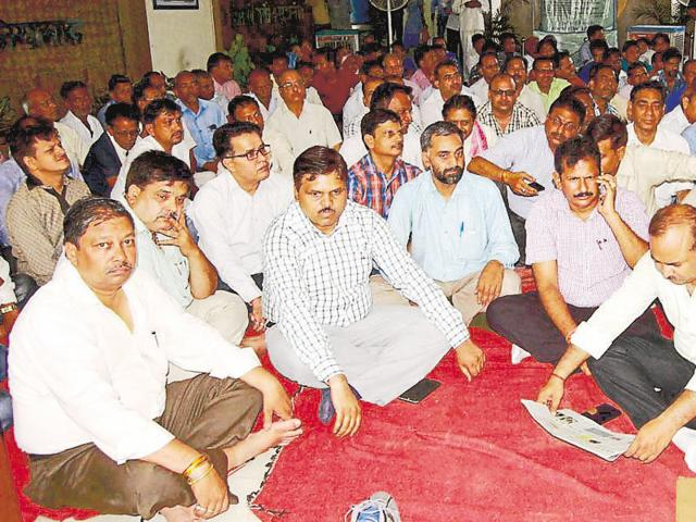 The striking employees said their demand is arrest of the accused persons who were involved in the attack on officials.
