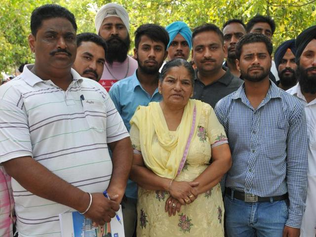 People who claim to victims of a visa fraud in Jalandhar on Wednesday.