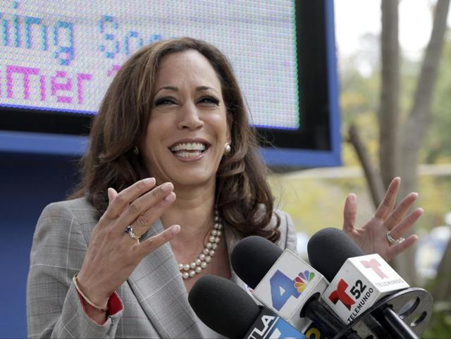 California attorney general Kamala Harris and her husband, Douglas Emhoff, vote at Kenter Canyon Elementary School in Los Angeles on Tuesday. The top two candidates for California's first open US Senate seat in 24 years will advance to a run-off election in November to replace retiring Barbara Boxer. Harris is a heavy favourite and fellow Democrat Loretta Sanchez is looking to hold off three Republican challengers for second place.