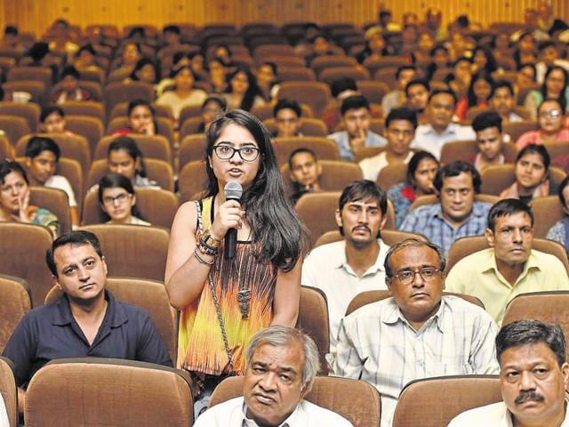 Students and parents attend the 'Open Day' session at Zakir Hussain College in New Delhi on Wednesday.