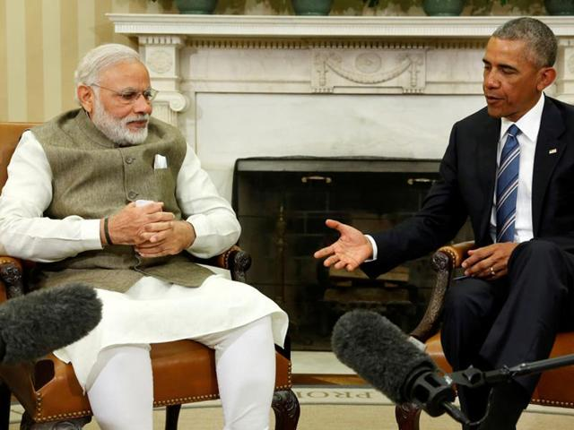 President Barack Obama and Indian Prime Minister India Narendra Modi shake hands in the Oval Office of the White House in Washington