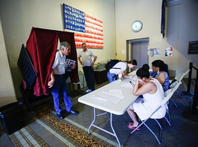 A man exits a booth after casting his ballot at polling station during New Jersey's primary elections.