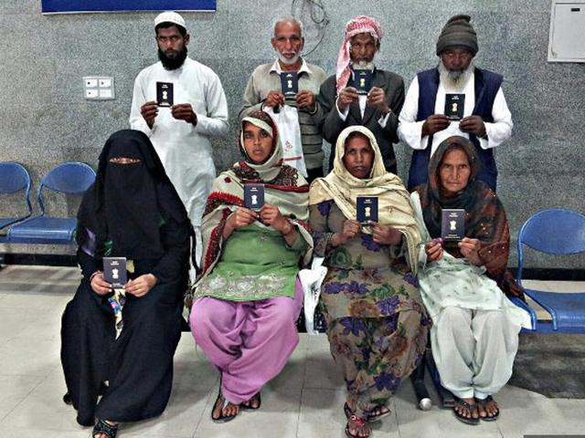 Indian citizens display their passports during a special drive held for Haj applicants at the regional passport office in Chandigarh in 2014.