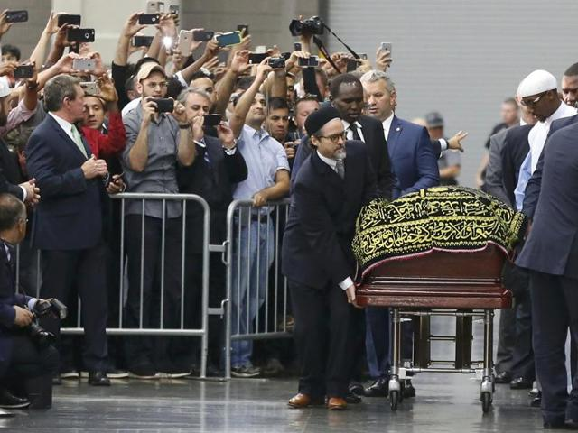 The coffin of late boxing champion Muhammad Ali arrives for a jenazah, an Islamic funeral prayer, in Louisville, Kentucky.