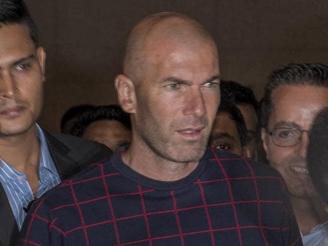 French footballer Zinedine Zidane arrives at the international airport in Mumbai.(Satish Bate/HT Photo)