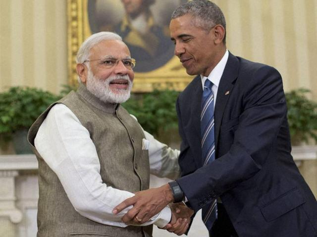 Prime Minister Narendra Modi and US President Barack Obama shake hands in the Oval Office of the White House in Washington on Tuesday.(AP Photo)