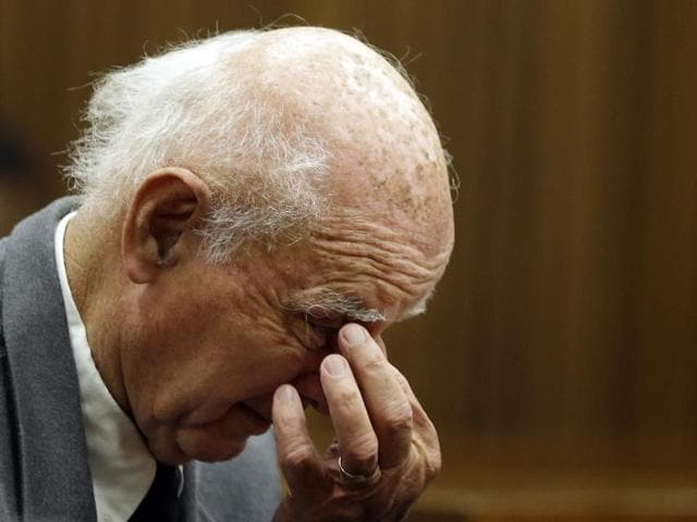 Bob Hewitt sits in the dock during his sentencing at the high court in Pretoria, South Africa.