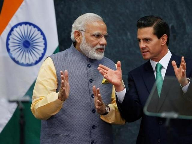 Prime Minister Narendra Modi speaks with Mexican President Enrique Pena Nieto after they gave a speech, at Los Pinos presidential residence in Mexico City.