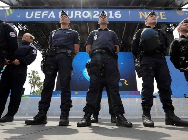 French police officers stand in the fan zone in Nice, southeastern France, two days before the start of the Euro 2016 football championship.