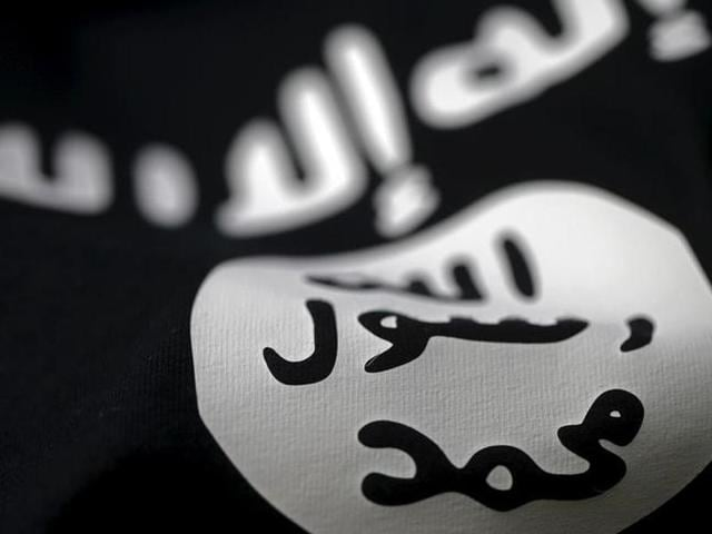 An Islamic State flag is seen in this picture illustration
