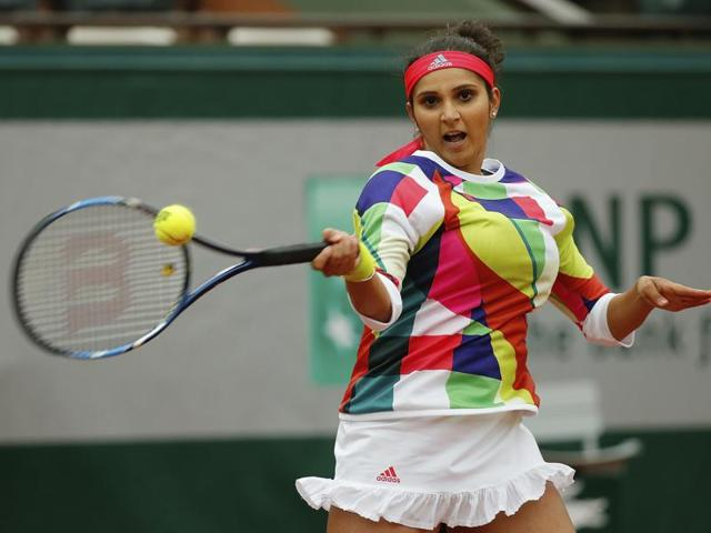 Sania Mirza hits a return when playing with Croatia's Ivan Dodic in the final of the mixed doubles match of the French Open tennis tournament.