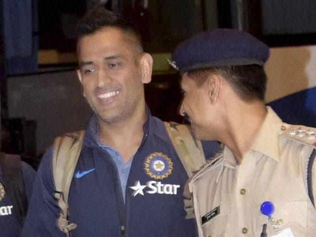 Dhoni shares a smile with a CISF personnel while leaving for Zimbabwe from Mumbai international airport on Wednesday.