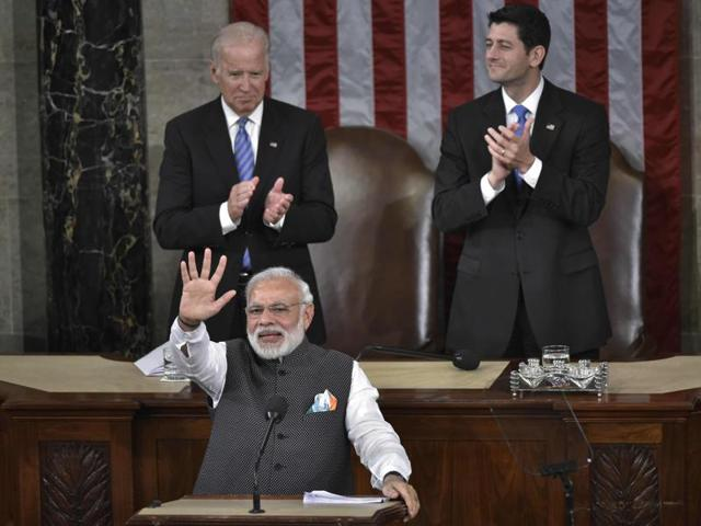 Prime Minister Narendra Modi waves before addressing a joint meeting of Congress on Capitol Hill in Washington, June 8, 2016