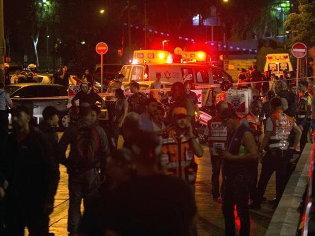 Israeli security personnel secure the area where the shooting attack took place in the centre of Tel Aviv.