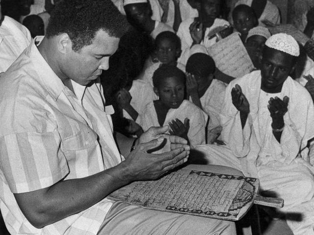 In this file photo, former world heavyweight boxing champion Muhammad Ali prays with a class of Muslim boys at Dafaalah el Sa'em Mosque in Khartoum, Sudan.