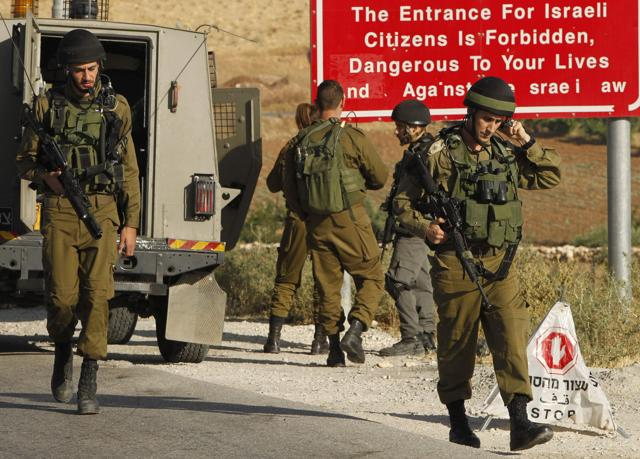 Israeli soldiers in the Palestinian village of Yatta in the occupied West Bank on Thursday, a day after an attack in the Israeli city of Tel Aviv left four people dead and 16 others wounded.
