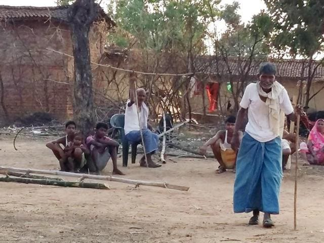 Elders of Harijan tola suffering from fluorosis have bent backs and cannot walk without stick at Pratapur village in Garhwa.