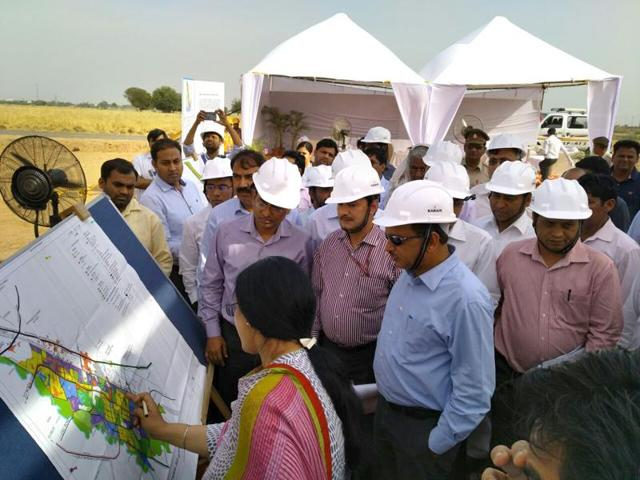 Officials inspected the site for the Delhi-Mumbai Industrial Corridor in Greater Noida in April .